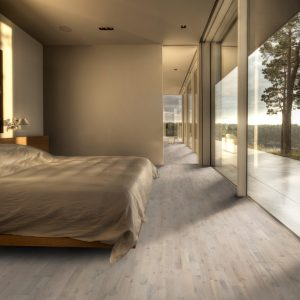 Beautiful light grey Kahrs Harmony Shell wooden flooring in a bedroom setting